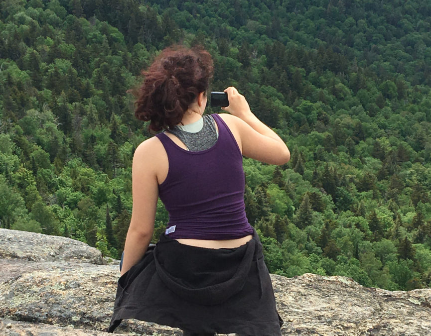 Sitting on top of a mountain, looking out and taking in the view