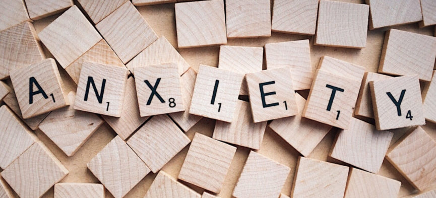 The word Anxiety spelled out with Scrabble tiles