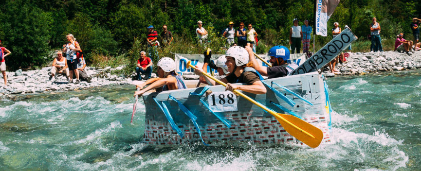 homemade cardboard boat racing through river rapids