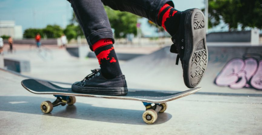 A focused view of skateboarder's feet on the ramp